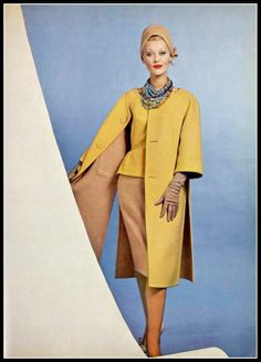 Model in mustard and tan wool ensemble, the coat is reversible, by Jean Dessès, hat by Paulette, photo by Georges Saad, 1960