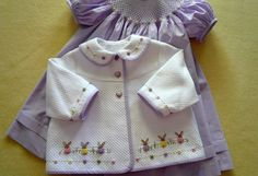 "KIT to MAKE ~ Buttons and Bunnies -1/32"" Pima lavender micro-check & white Dakota Pique are used to create this enchanting duo of bishop dress & cute swing jacket. The simple smocking design is perfectly finished with tiny pastel buttons, highlighting the colors used to stitch the endearing bullion knot bunnies around the lower edge of the jacket. Pima micro-check is also used to bind the jacket edges and matching buttons trim the hem, collar and sleeves.~ so Cute!"