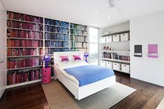 You may not have a wall of bookcases like this room does, but you can make this rainbow look work even on a small bookcase. It's a great way to turn something ordinary in to a piece of art.