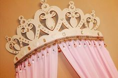This Baby nursery bed crown is perfect for your little princess. The second picture shows the colors better!!! The first pic isnt the best, sorry!  I