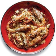 The Greek dish_ garides saganaki,_ a bubbling concoction of shrimp, tomatoes, onions, peppers, and feta spiked with a shot of ouzo, was invented in the 1950s, most likely at a restaurant in a seaport like Thessaloniki. See the recipe »