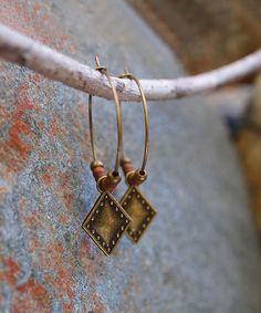 Take a look at this Bronzetone & Rust Beaded Hoop Earrings today!