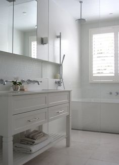 tiles   Anna Carin Design [ACD]. I love the tiles below the mirrored cabinets in this simple white bathroom/wetroom