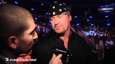 WWE's Undertaker, Brock Lesnar Exchange Words Following UFC 121