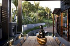 Interior/exterior overflow at the Owhanake Bay House in New Zealand by Strachan Group Architects