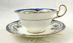 Aynsley Tea Cup and Saucer with Blue Border and Hand by TheAcreage