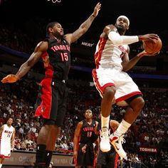 The Heat's LeBron James tries to get off a shot around the Raptors' Amir Johnson during Wednesday's game.
