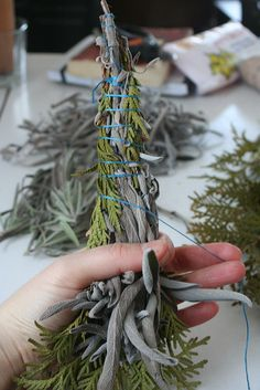 we made our own a few years ago with sage but forgot the cedar and lavendar....Smudge sticks! What a great housewarming gift.