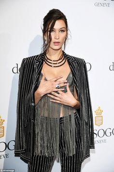 Incredibly chic: Bella Hadid shone bright at the jewellery bash as she slipped into a beda...