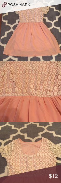 Peace and creme crochet detail skater dress This peach and cream dress from Forever 21 is so feminine and adorable! Top features a cream crochet overlay with sheer sleeves, an elastic waist, and a deeper scoop in the back. Bottom is peach chiffon with a full lining. Has loops for a belt, but one was not included when purchased. Top part of dress is fairly stretchy, size is Large, comes slightly above the knee. I'm fairly busty and had no issues! Only worn once. Forever 21 Dresses