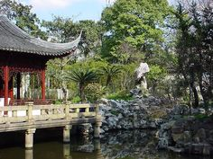 Chinese garden, Shanghai. Note the rocks featured in the garden. Japanese gardens use rocks like this to mimic mountains, but since the karst formations of China and the volcanic mountains of Japan look different, the rocks they choose to use in their gardens are different.