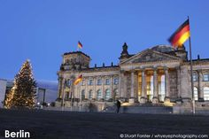A Christmas tree stands by the Reichstag Building in Berlin, Germany.