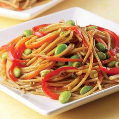 Recipe of the Day: This gorgeous, tasty dish is a healthy play on lo mein that's just perfect for a summer weeknight dinner. Edamame is the star - packed with energizing lean vegetarian protein and other good-for-you nutrients like fiber, calcium, and potassium, this Asian-inspired will fill you up for little calories.  #edamame #lomein #healthyrecipes #lowcalrecipe
