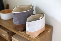 Leather Bottomed Pouches - Noodlehead, two open wide zippered pouches using leather and Studio Stash Yarn Dye fabric.