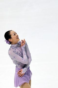 """Mao Asada, ending pose and smiles as she finished her """"Liebestraume"""" free program by Franz Liszt, at the All Japan Nationals Championships Women's free program. December ・ Photo by Ikujima Kentaro Figure Skating Dresses, Women Figure, National Championship, Hanyu Yuzuru, Skate, Beautiful People, Athlete, Poses, Lady"""