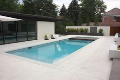 pool, cool chairs, white pool balls, decorative concrete smooth, brush finished pool deck
