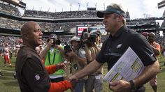 Head coach Hue Jackson of the Cleveland Browns shakes hands with head coach Doug Pederson of the Philadelphia Eagles after the game at Lincoln Financial Field on September 11, 2016 in Philadelphia, Pennsylvania. The Eagles defeated the Browns 29-10.