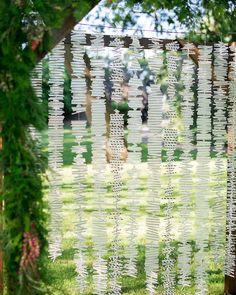Creative backdrop of paper straws for this Alicein Wonderland Garden #Wedding Ideas.