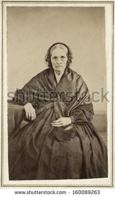 Circa 1865 Older Woman dressed in Victorian style hoop dress clothing from the Civil War era, possibly a mourning gown with a shawl. You can purchase a digital copy at the above link.