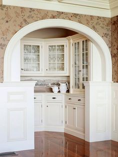 Style-defining architectural features Arched Trim The extra emphasis of detailed trim can highlight a great architectural element, such as the elegant curve of this arched-nook butler's pantry. Kitchen Cabinets Decor, Farmhouse Kitchen Cabinets, Cabinet Decor, Kitchen Ideas, Pantry Ideas, Architectural Features, Architectural Elements, Moldings And Trim, Ideas Hogar