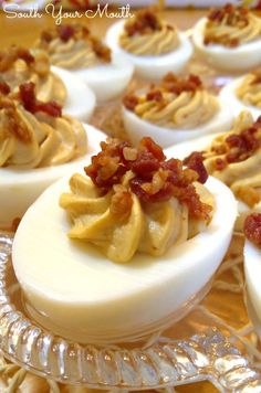 Deviled eggs with sriracha and crumbled bacon.