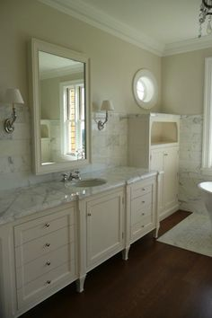 Steve Giannetti used a marble slab in this master bathroom and then tiled the walls in the Carrara subway size. Next, he used tiny mosaic sized marble to create a mat underneath the bathtub! (From Cote De Texas: White Marble for the Kitchen, Yes or No? Marble Bathroom Floor, Cream Bathroom, Bathroom Flooring, White Bathrooms, Marble Floor, Marble Bathrooms, Master Bathrooms, Cream Cabinets, White Cabinets