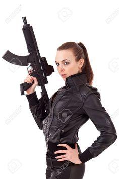 Mujer Joven Posando Con Armas De Fuego A Fotos, Retratos, Imágenes Y Fotografía De Archivo Libres De Derecho. Image 15348404.