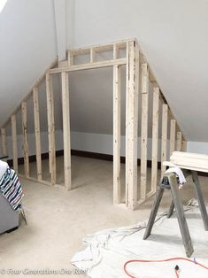 How to Frame a Closet with Low Slanted Ceiling {Lady Loft} Need a closet? How to frame a closet with a slanted ceiling in 3 hours. I love the idea of creating a walk in closet in an attic or loft. Perfect for storage or attic bedroom closet. Attic Bedroom Closets, Attic Bedroom Small, Attic Bedroom Designs, Attic Rooms, Closet Bedroom, Closet Wall, Closet Doors, Small Attic Bathroom, Attic Bedroom Storage