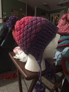 Cross hatch crochet hat -- like the cross hatching, but not the earflaps -- would just do it as a beanie or slouch
