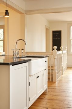 modern sensibility in historic kitchen: soapstone counters, farmhouse sink, Rohl faucet