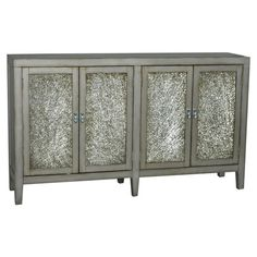 Crackled glass door inserts give this classic console table a touch of sparkle. Store folded linens and platters inside for a convenient sideboard, or add it...