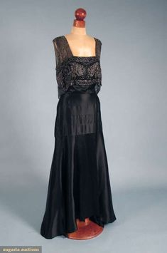 BEADED SATIN TRAINED EVENING GOWN, 1930s Black bias-cut silk charmeuse, square front neckline, silver beaded silk net over front & back bodice, deep V back w/ V shape beaded panel & long bead tassel.