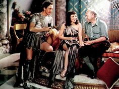 "Fredric March (1897-1975), Claudette Colbert (1903-1996) and director Cecil B. DeMille (1881-1959) on the set of ""The Sign of the Cross"", 1932"