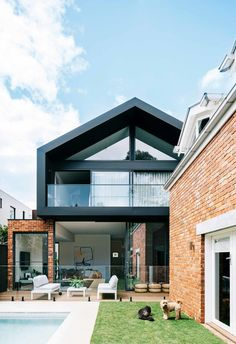 extending up and out has resulted in a large living space and a better link to the garden and separate studio apartment. A deck flows between the dwellings.The red brick facade is complemented by the modern extension. Source by insideoutpins Modern Brick House, Modern House Facades, Modern House Design, Red Brick Exteriors, Brick Facade, Facade House, Facade Design, Exterior Design, Bungalow Extensions