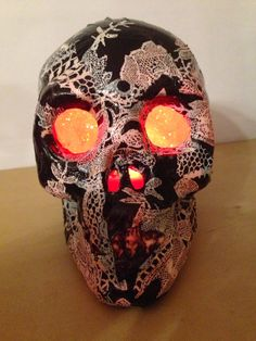 Light up skull done in decoupatch