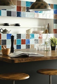 Patchwork kitchen splashback featuring a mix and match selection of Ormeaux tiles. Handmade ceramic tiles from the Chateaux collection by The Winchester Tile Company. winchestertiles.com