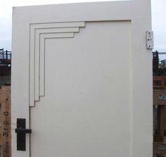 A rather unimaginative art deco door, but good idea. Just not well executed.