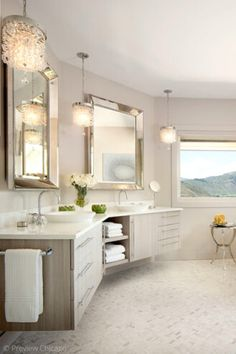 We love the double vanity and glam lighting in this master bathroom. Thinking about updating your bathroom? Find all the bathroom design inspiration you could want in this post as we share 13 beautiful bathroom decor ideas to inspire your next bathroom remodel. From bold wallpaper, elegant powder rooms, soaker tubs, glass shower enclosures, brass, gold and silver bathroom fixtures, to chandeliers and elegant pendant lighting in the bathroom, we have you covered! Hadley Court Interior Design Blog