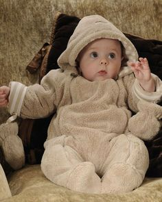 Our Unisex Baby Fur Pramsuit is our softest yet and our number one bestseller  Plush fur outer 100% superfine cotton stripe lining 2 zip full opening for easy dressing Removable mittens 100% Polyester outer/padding/ Lining 100% cotton Essential for any newborn and your hospital bag! Gender Neutral
