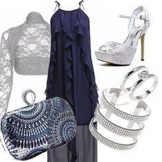 Pochette con paillettes blu ed argento. Sandali argento alti con strass e  cinturino alla caviglia. Accessori ... 6d2ee16463b