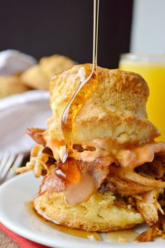 Pulled Pork Breakfast Biscuits is the best of Southern cuisine all in one breakfast. Top with maple syrup for a little sweetness.