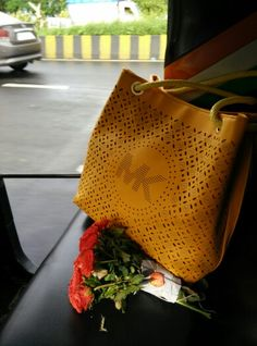 Auto ride my bag and flowers
