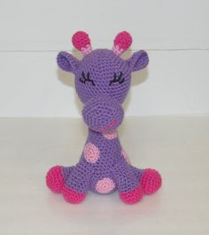 purple and pink crochet giraffe from etsy! great baby toy!