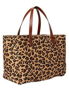 I have this tote - it's super cute.  Leopard printed canvas tote from The Gap.