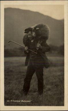"Shepherd ""A Lakeland Dalesman"" Holding Sheep Over Shoulders Real Photo c1910 PC"