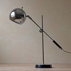 This industrial mid century lamp is the Eyeball desk lamp by ...