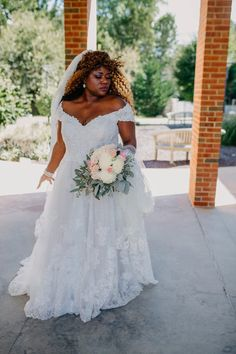 David's Bridal bride Glory in this off-the-shoulder lace wedding dress by Oleg Cassini   Photo by Brooke Silverman Photography