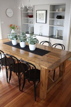 Dining Room Contemporary Rustic Dining Room Tables 6 Black Steel Chairs Have 3 Flowers Pot On The Table Above Laminate Wood Floor Around White Paint Wall Interior Decor The Desirable Rustic Dining Room Tables