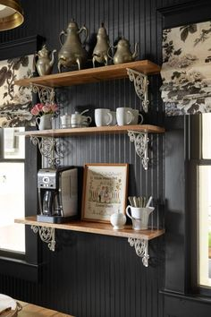 The couple finished off their mini-makeover by bringing in a few country kitchen staples: a farm table that doubles as an island; a brass light fixture that will develop patina over time; black-and-white floral curtains; and open shelves to display her collection of antique pewter and a favorite needlepoint.