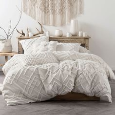 This season is all about texture and the Sanura Quilt Cover Set is the perfect way to add a chic pop of it to your bedroom décor! The quilt cover set features a range of textured details in a stunning cream tone and is beautifully soft to the touch.